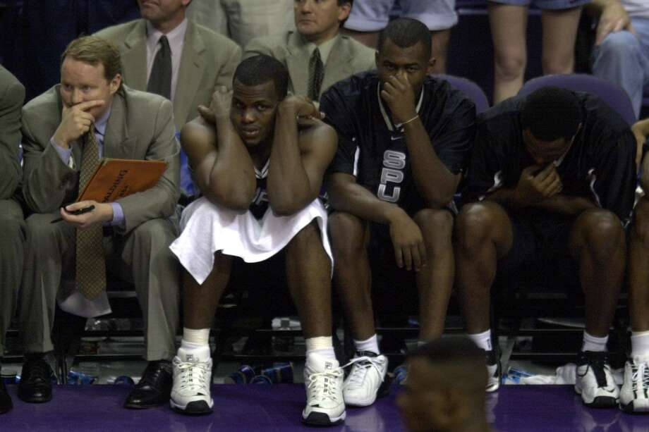 Spurs Mike Budenholzer, from left, Malik Rose, Derrick Dial and Jaren Jackson react as they lose to the Phoenix Suns in game 3 of the opening round of the playoffs Saturday April 29, 2000 at the America West Arena in Phoenix, Ariz. (San Antonio Express-News file photo)