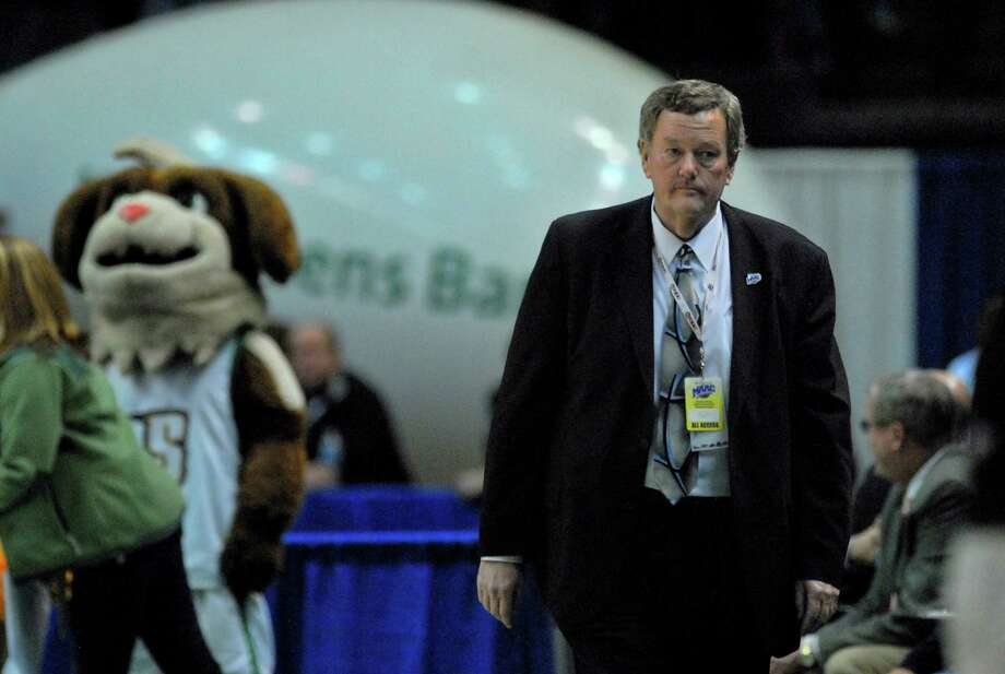 MAAC commissioner Rich Ensor walks near the court during Siena's  third straight MAAC Tournament win, a 72-65 overtime victory over Fairfield at the Times Union Center in Albany, NY on Monday night March 8, 2010.  (Philip Kamrass / Times Union) Photo: PHILIP KAMRASS / 00007765A