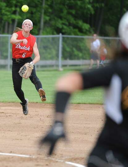 Guilderland shortstop Jenna Cubello throws the ball to first base during a Class AA Section II softb
