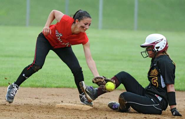 Guilderland second baseman Tori Greco puts the tag on Colonie's Amanda Marchesini who was called safe during a Class AA Section II softball semifinal on Wednesday, May 29, 2013 in Colonie, N.Y.  (Lori Van Buren / Times Union) Photo: Lori Van Buren / 00022607A