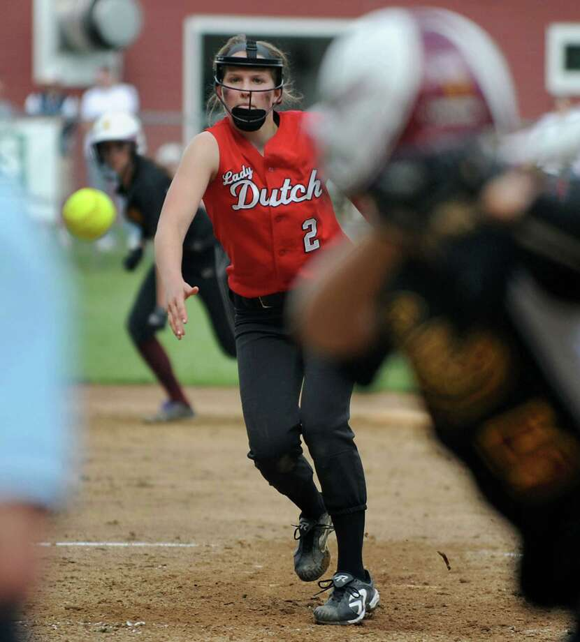 Guilderland pitcher Taylor Tewkbury throws the ball with a runner on second during a Class AA Section II softball semifinal against Colonie on Wednesday, May 29, 2013 in Colonie, N.Y.  (Lori Van Buren / Times Union) Photo: Lori Van Buren / 00022607A