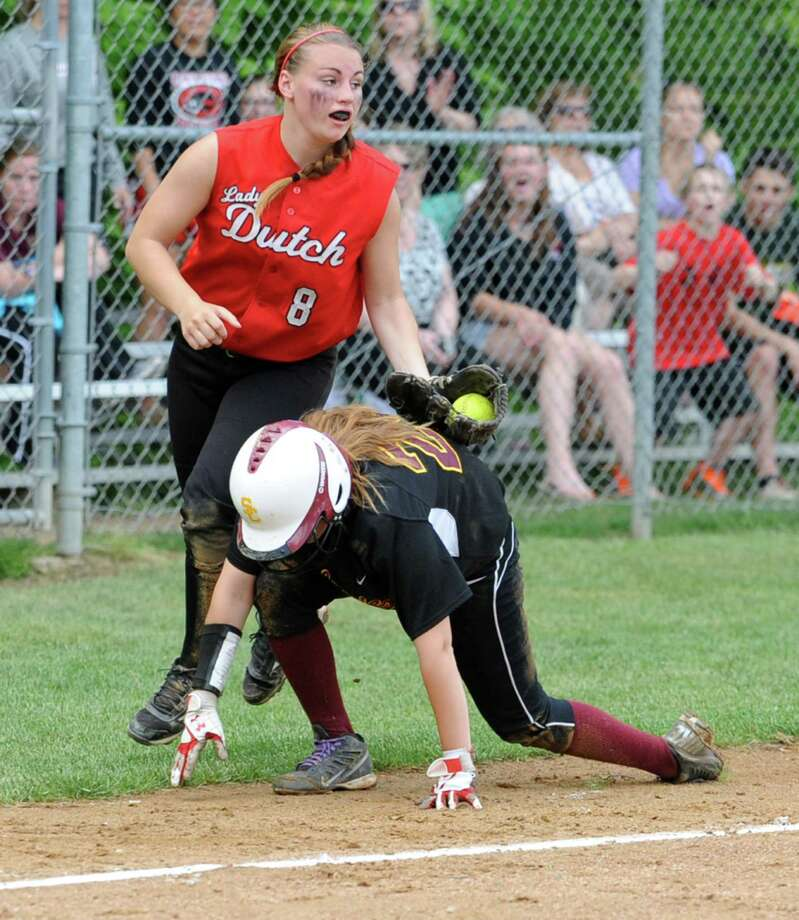 Guilderland's Mallory Harrigan tags out Colonie's Emily Loudis who was caught in a pickle between third and home during the Class AA Section II softball semifinal on Wednesday, May 29, 2013 in Colonie, N.Y.  (Lori Van Buren / Times Union) Photo: Lori Van Buren / 00022607A