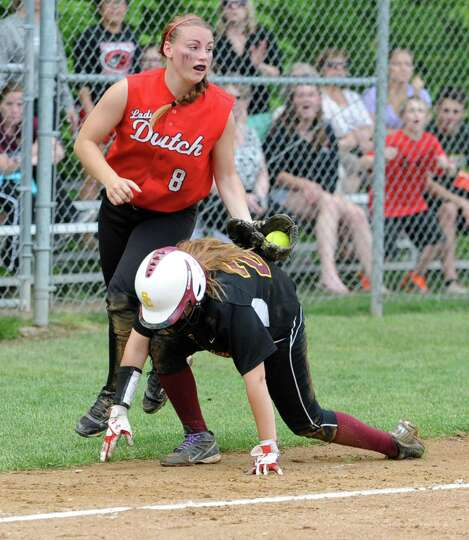 Guilderland's Mallory Harrigan tags out Colonie's Emily Loudis who was caught in a pickle between th
