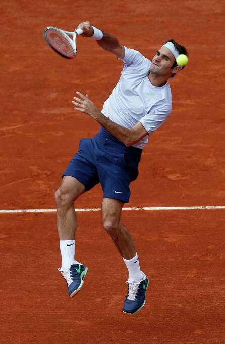 Switzerland's Roger Federer smashes the ball as he plays India's Somdev Devvarman during their second round match of the French Open tennis tournament at the Roland Garros stadium Wednesday, May 29, 2013 in Paris. (AP Photo/Petr David Josek) Photo: Petr David Josek