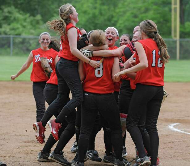 The Guilderland girls celebrate after defeating Colonie in the Class AA Section II softball semifina