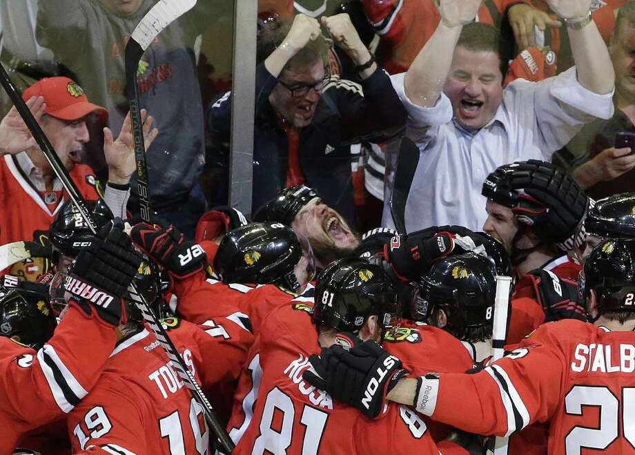 Chicago defenseman Brent Seabrook (center back) celebrates with teammates after scoring for a 2-1 OT win in Game 7 of the Western Conference semifinals. Photo: Nam Y. Huh / Associated Press