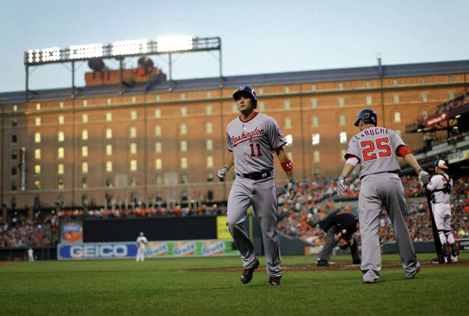 The Nats' Ryan Zimmerman (11) hit three home runs, but Chris Davis went 4 for 4 with two homers to lead Baltimore to victory. Photo: Patrick Semansky / Associated Press
