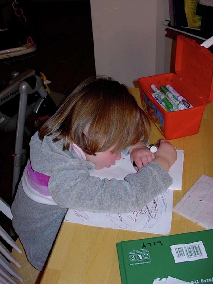 She fell asleep mid-scribble. Photo: Newman-erin