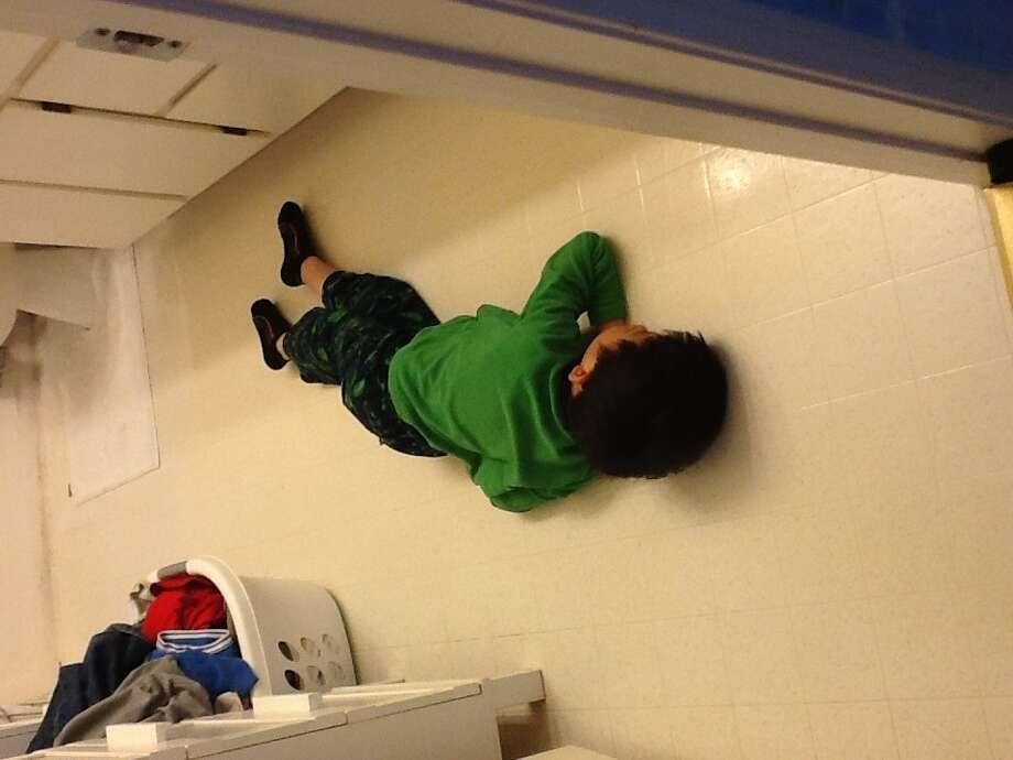 Snoozing on the bathroom floor. Photo: Hendra-tambunan