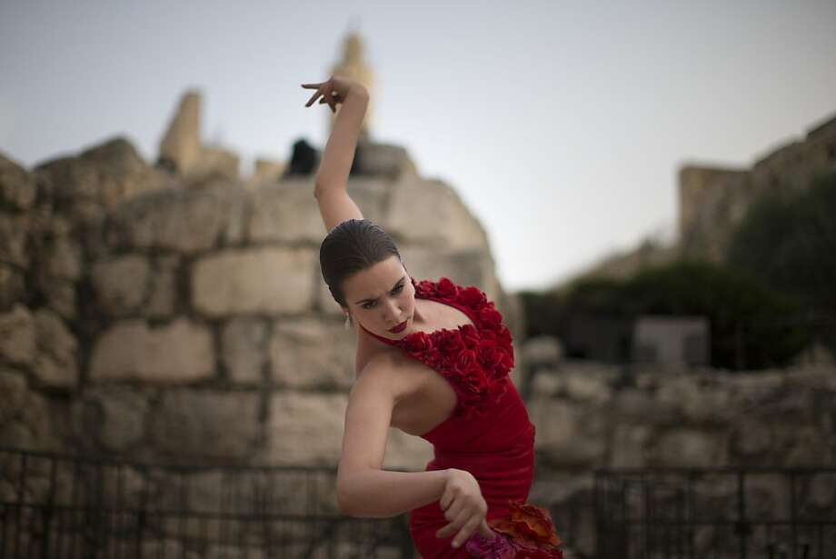 "Everyone expects the Spanish exposition: A ""Dressed to Dance"" performer rehearses a Flamenco number before the show at the Tower of David in Jerusalem's old city. The show features 20th century outfits designed by Picasso, Salvador Dali and other artists. Photo: Uriel Sinai, Getty Images"