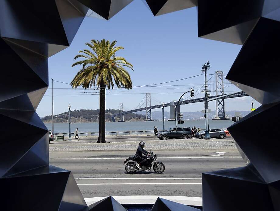 "The sculpture ""Aurora"" by artist Ruth Asawa frames a waterfront scene along The Embarcadero in San Francisco, Wednesday,  May 29, 2013. (AP Photo/Marcio Jose Sanchez) Photo: Marcio Jose Sanchez, Associated Press"