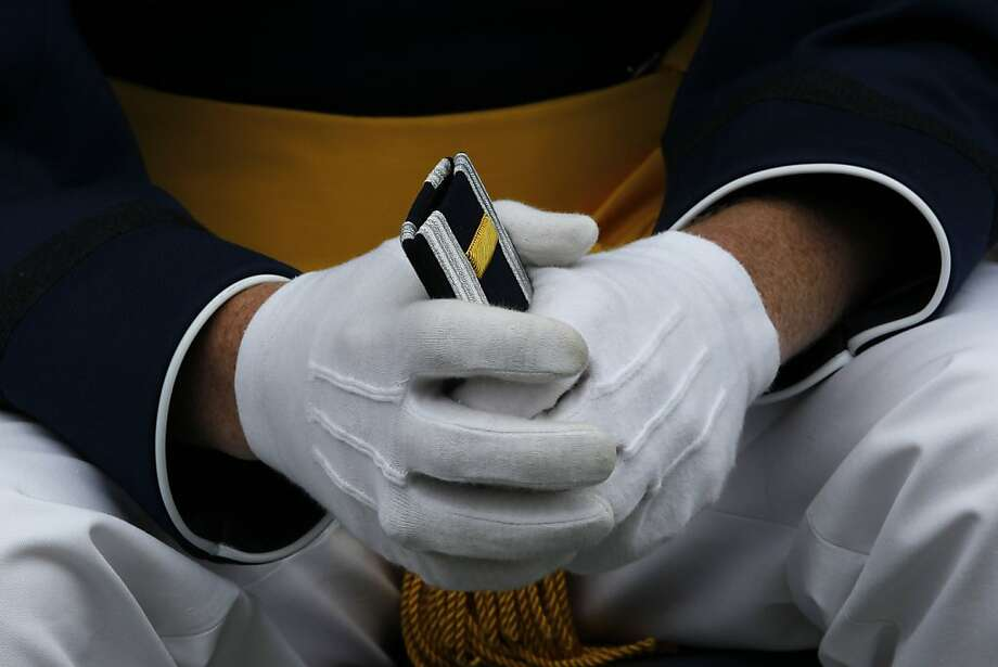 A graduating cadet holds his 2nd Lieutenant's stripes, his to wear following the commencement ceremony for the class of 2013, at the U.S. Air Force Academy, in Colorado, Wednesday May 29, 2013. (AP Photo/Brennan Linsley) Photo: Brennan Linsley, Associated Press