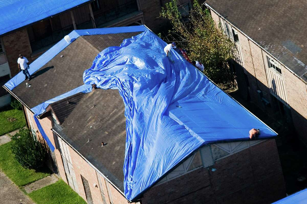 A rooftop near Hobby Airport dons a blue tarp Sept. 24, 2008, after Ike's wrath.
