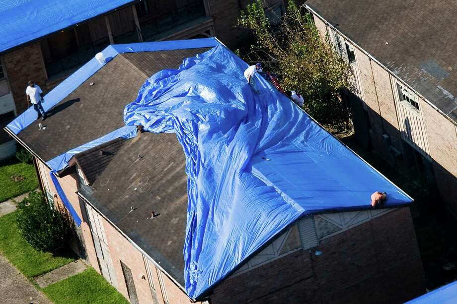 A rooftop near Hobby Airport dons a blue tarp Sept. 24, 2008, after Ike's wrath. Photo: Smiley N. Pool, Staff / Houston Chronicle