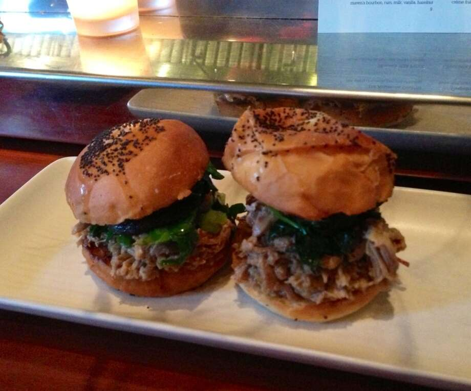 Chinatown duck sliders ($9) with greens, bacon and shiitake mushrooms