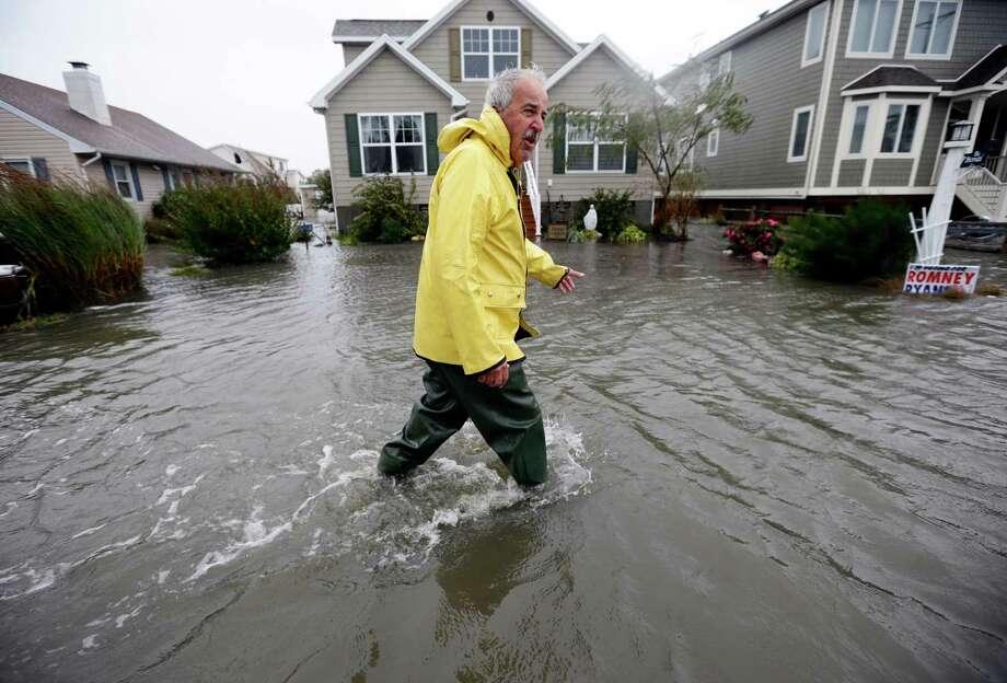 Richard Thomas' Fenwick Island, Del., neighborhood flooded after Hurricane Sandy in 2012. Photo: Alex Brandon, STF / 2012 AP