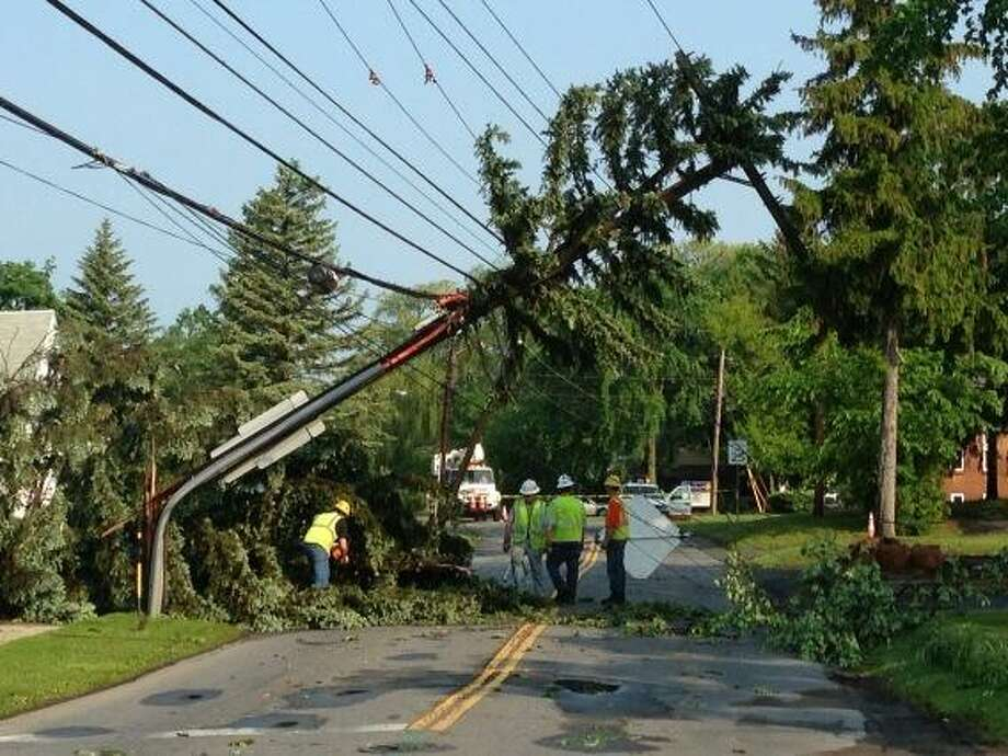 Schenectady and National Grid workers start clearing a downed utility pole on Consaul Road in Schenectady on Thursday, May 30, 2013. (Skip Dickstein / Times Union)