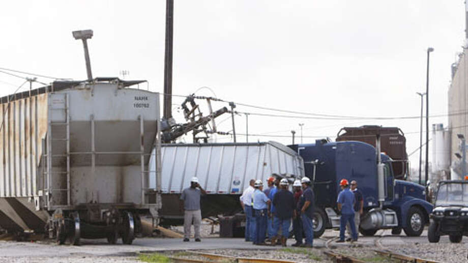 A train slammed into an 18-wheeler Thursday morning, backing up motorists in the Ship Channel area. It's the second such wreck in two days in the Houston area. Photo: (Cody Duty / Houston Chronicle)