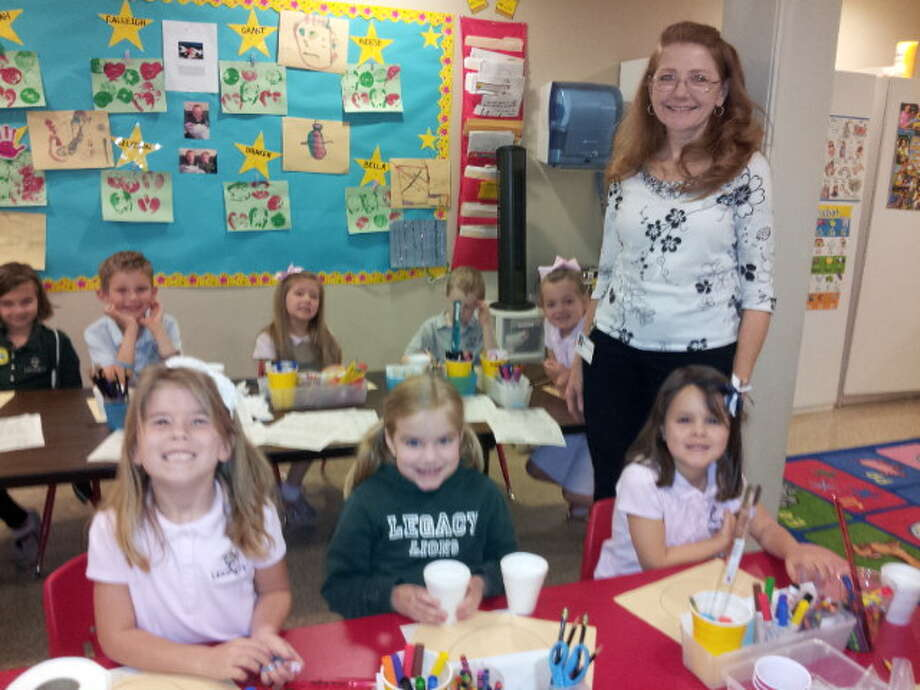 Debbie Pirkle, seen here with several of her students, is now in her eighth year at Legacy Preparatory Academy.