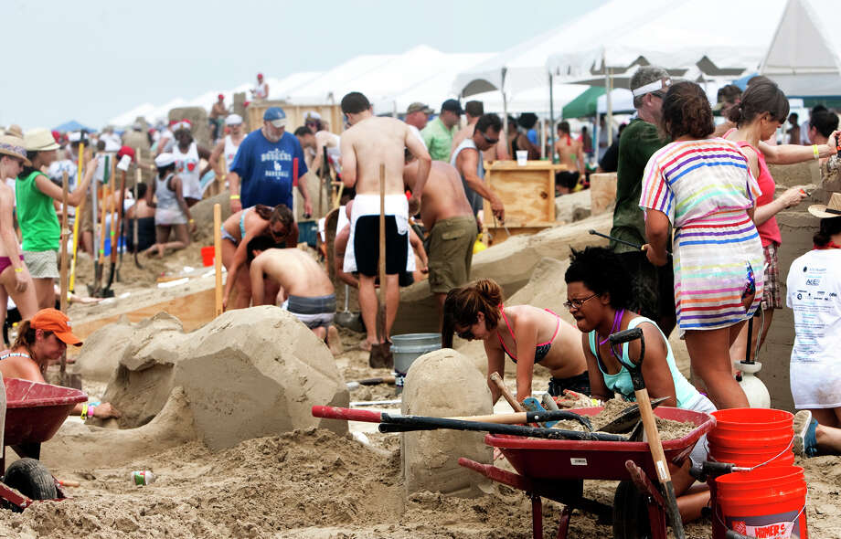 Teams work on their sand sculptures during the 26th annual AIA SandCastle Competition on Galveston's East Beach Saturday, June 2, 2012, in Galveston. Photo: Cody Duty, Houston Chronicle / © 2011 Houston Chronicle
