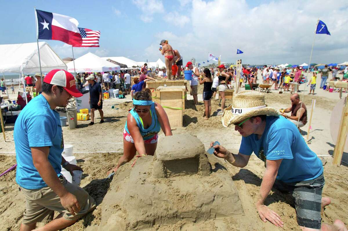 Jim Chen, left, Angelina Ross, center, and Brey Tucker, right, work on their sand sculpture themed Dunes Day At the Beach during the 26th annual AIA SandCastle Competition on Galveston's East Beach Saturday, June 2, 2012, in Galveston. Each team used different tools ranging from shovels, just their hands and feet, and customized tools to shape their castles.