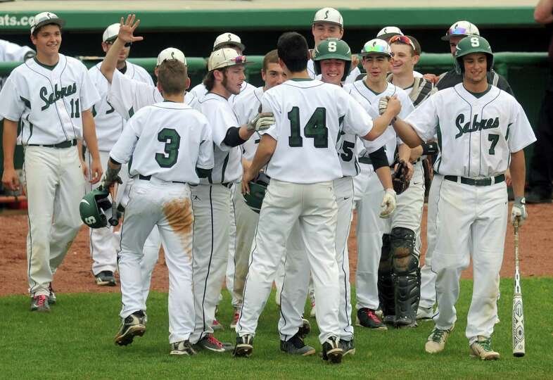 Schalmont's John Pascarella, (#14), is congratulated by teammates after hitting a home run during th