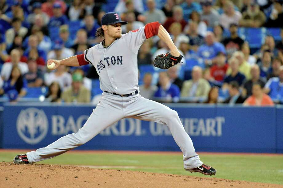 Boston Red Sox starting pitcher Clay Buchholz throws against the Toronto Blue Jays during the first inning of their baseball game, Wednesday, May 1, 2013, in Toronto. (AP Photo/The Canadian Press, Nathan Denette) Photo: Nathan Denette, SUB / The Canadian Press