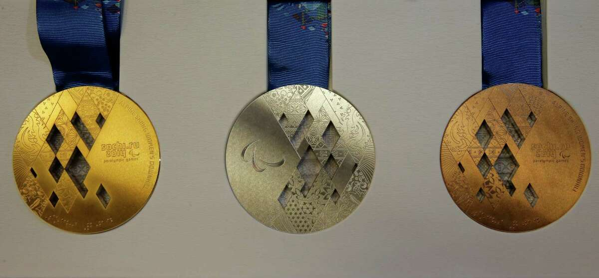The gold, silver and bronze paralympic medals are displayed for journalists during presentation of Sochi 2014 medals at the SportAccord International Convention in St. Petersburg, Russia, Thursday, May 30, 2013. (AP Photo/Dmitry Lovetsky)