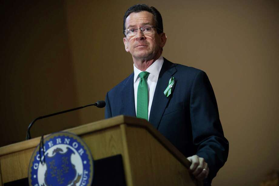 Gov. Dannel Malloy said he would sign a House-approve measure to raise the state's minimum wage from its current $8.25 an hour to $9 by Jan. 1 2015. Photo: Christopher Capozziello, Getty Images / 2013 Getty Images