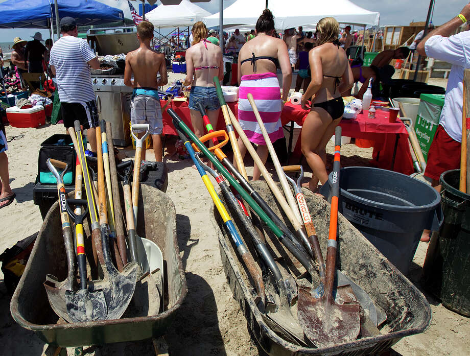 Tools for teams to make their sand sculptures are seen during the 26th annual AIA SandCastle Competition on Galveston's East Beach Saturday, June 2, 2012, in Galveston. Photo: Cody Duty, Houston Chronicle / © 2011 Houston Chronicle