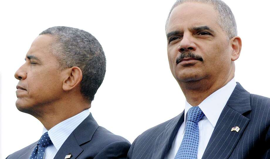 President Barack Obama and Attorney General Eric Holder attend the 32nd annual National Peace Officers' Memorial Service. Ending the presumption that African-American and Hispanic men are beyond redemption would be a powerful legacy for the first black president and the first black attorney.  Photo: Pool, Getty Images / 2013 Getty Images