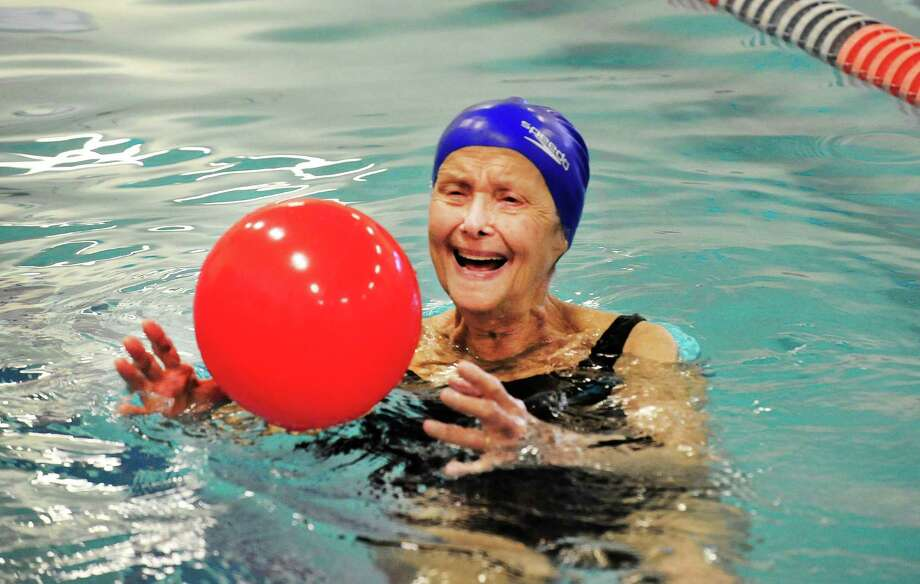 "Ellie Potter, 90, swims at 6 a.m., seven days a week, at the Boughton Street YMCA in Danbury, Conn. She has been following this routine for 30 years, arriving with fresh baked cookies for the staff each morning. She still drives her car and loves to drive fast. She says ""I guess God don't want me yet!"" Photo: Michael Duffy / The News-Times"