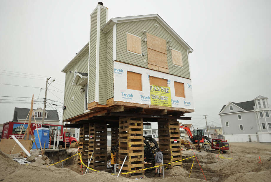 A waterfront home damaged during Hurricane Sandy is raised high above the sand on East Broadway in Milford, Conn. on Thursday, May 23, 2013. Photo: Brian A. Pounds
