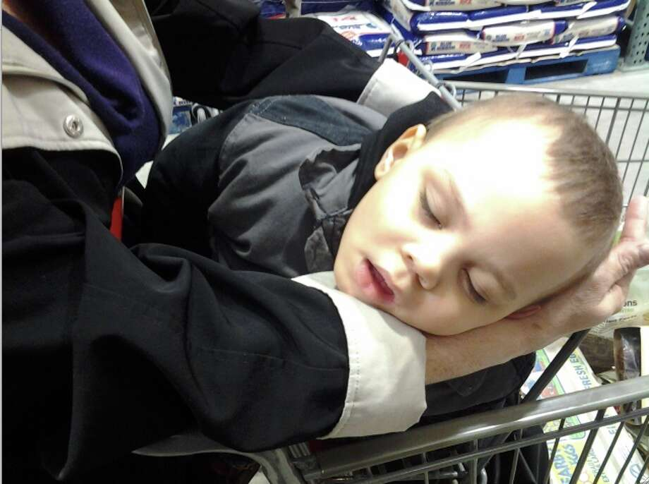 This young man didn't find the trip to costco as exciting as the rest of his family did.
