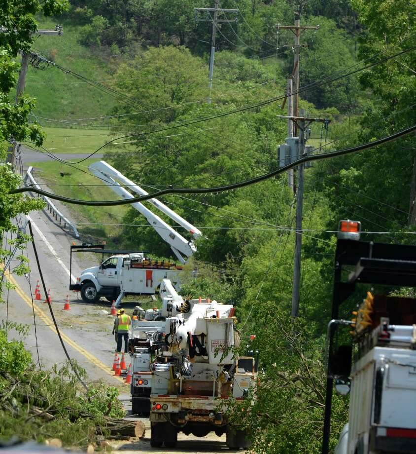 Utility workers continue to get clients back on line on Putnum Road May 30, 2013, in Mariaville, N.Y.   (Skip Dickstein/Times Union) Photo: SKIP DICKSTEIN