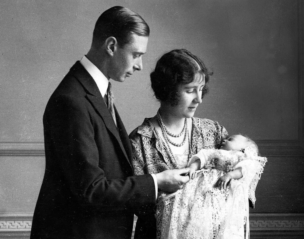 The Duke and Duchess of York pictured with their daughter as she sleeps in a precious christening robe, which has been used in the Royal Family for generations in 1926.