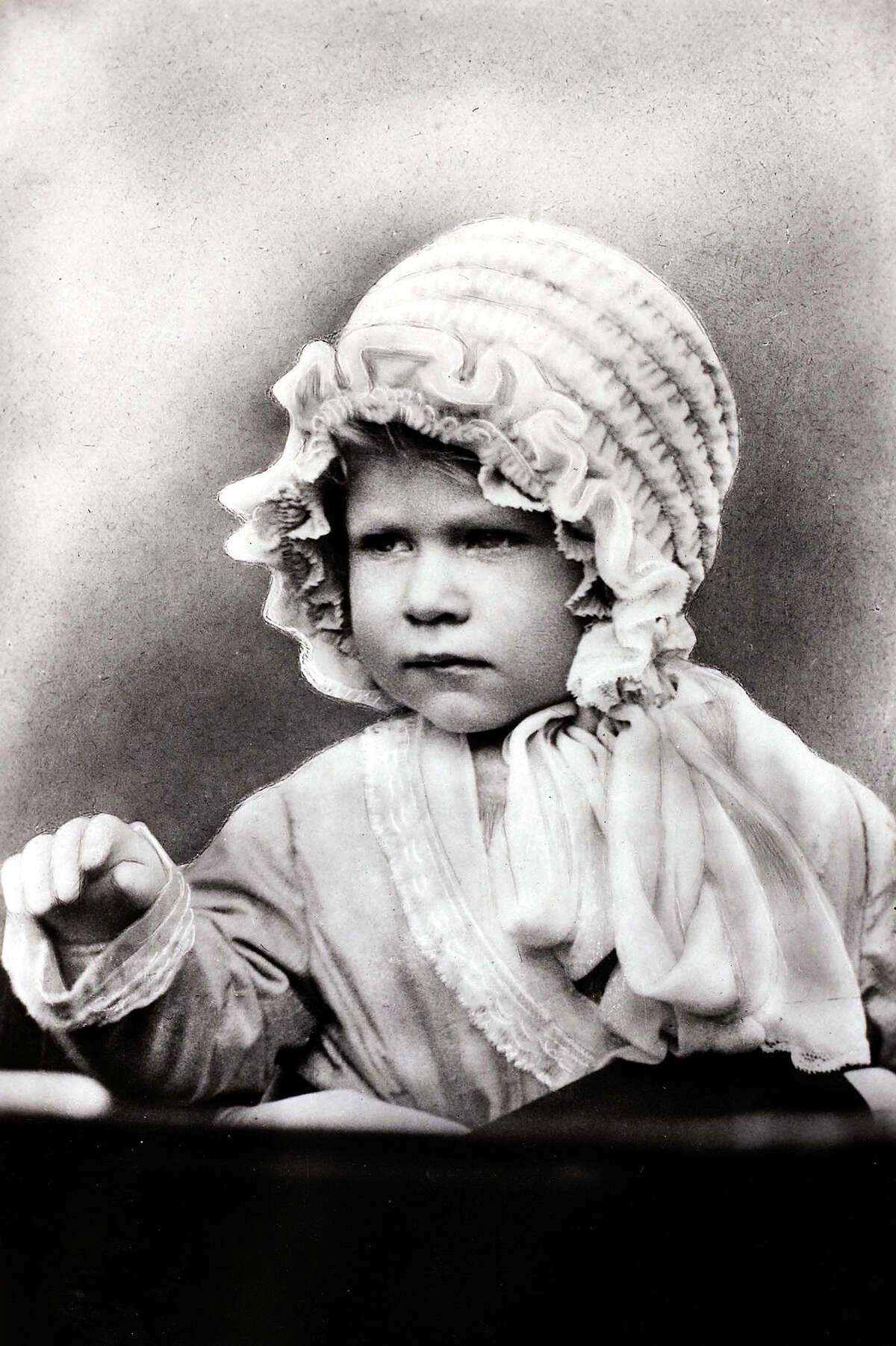 British Royalty, circa 1927, HRH Princess Elizabeth wearing a cute bonnet, the daughter of The Duke and Duchess of York.