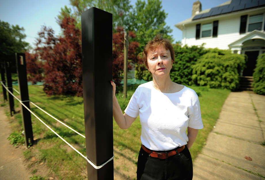 Eileen Ryan is fighting with the city of Ansonia to erect a fence around her home at 281 Wakelee Avenue. Photo: Brian A. Pounds / Connecticut Post
