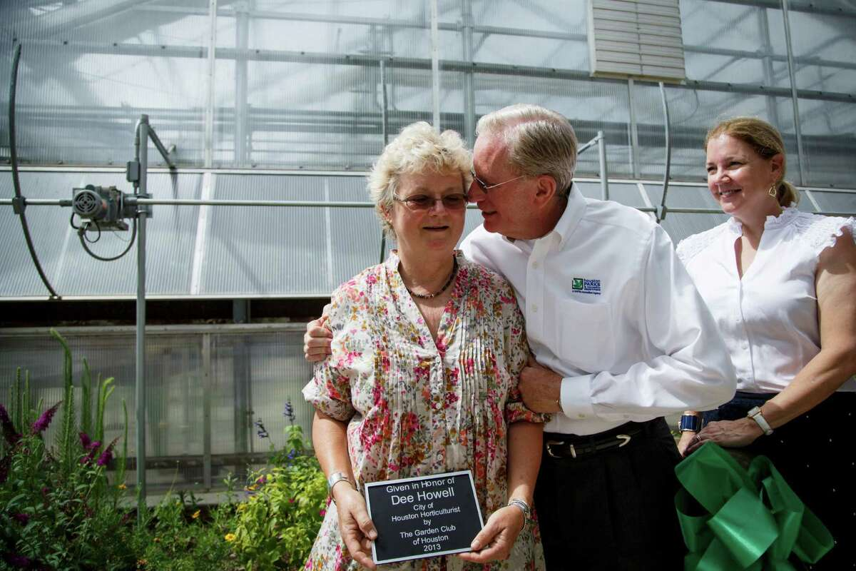 Dee Howell, left, senior superintendent of horticulture services, reacts along with Joe Turner during a dedication ceremony at the new Demonstration Beds at the Memorial Park Greenhouse, Thursday, May 30, 2013, in Houston.