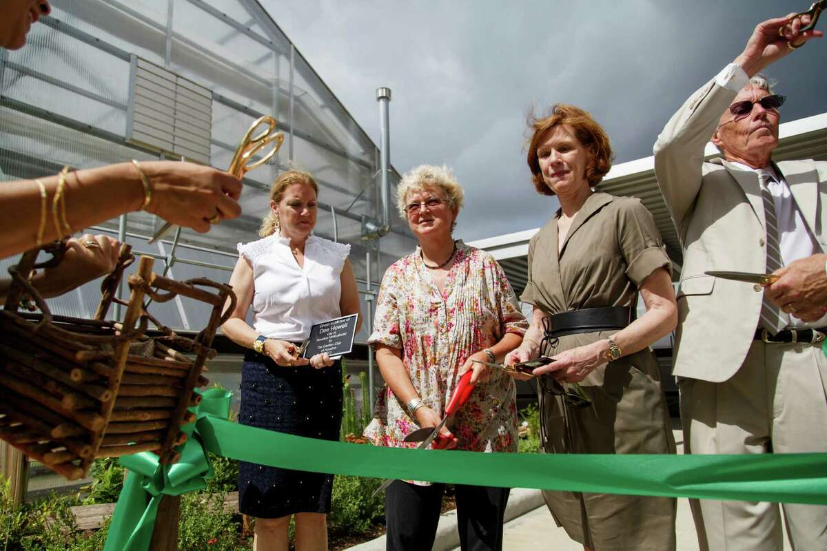 Debbie Robinson, left to right, Dee Howell and Susan Peterson cut the ribbon during a dedication ceremony at the new Demonstration Beds at the Memorial Park Greenhouse, Thursday, May 30, 2013, in Houston.