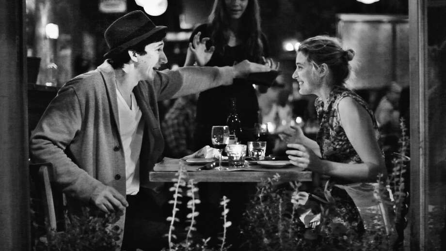 "This undated publicity photo released by the Independent Film Channel shows Greta Gerwig, right, as Frances, with Adam Driver as Lev having dinner in a scene from the film, ""Frances Ha."" (AP Photo/IFC) / IFC"