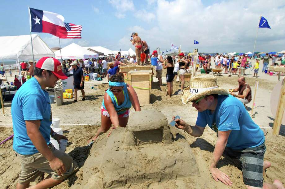 Jim Chen, left, Angelina Ross, center, and Brey Tucker, right, work on their sand sculpture themed Dunes Day At the Beach during the 26th annual AIA SandCastle Competition on Galveston's East Beach Saturday, June 2, 2012, in Galveston. Each team used different tools ranging from shovels, just their hands and feet, and customized tools to shape their castles. Photo: Cody Duty, Houston Chronicle / © 2011 Houston Chronicle