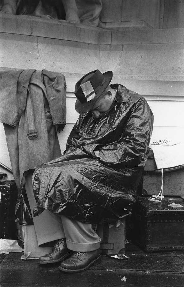 A Fleet Street reporter takes a nap whilst waiting for some action on the day of the Coronation. Photo: Picture Post, Getty Images / Picture Post