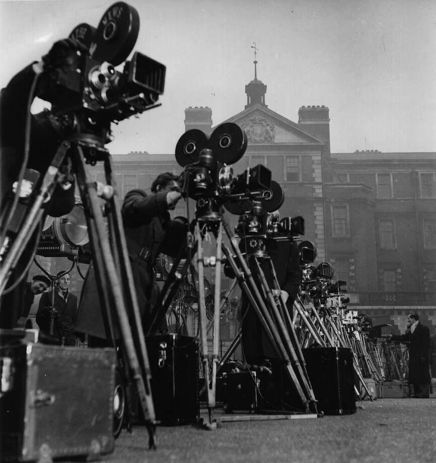 A line of movie cameras and tripods set up for the Coronation. Photo: Ronald Startup, Getty Images / Picture Post