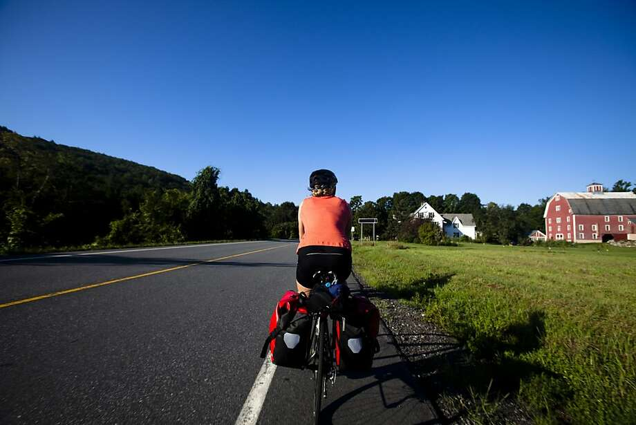 A cyclist pedals leisurely through the farmlands of central Vermont. Leisurely is a good pace for meandering around Vermont. Go fast, and it's over too quickly. Photo: Kyle Sparks, Getty Images/Aurora Open