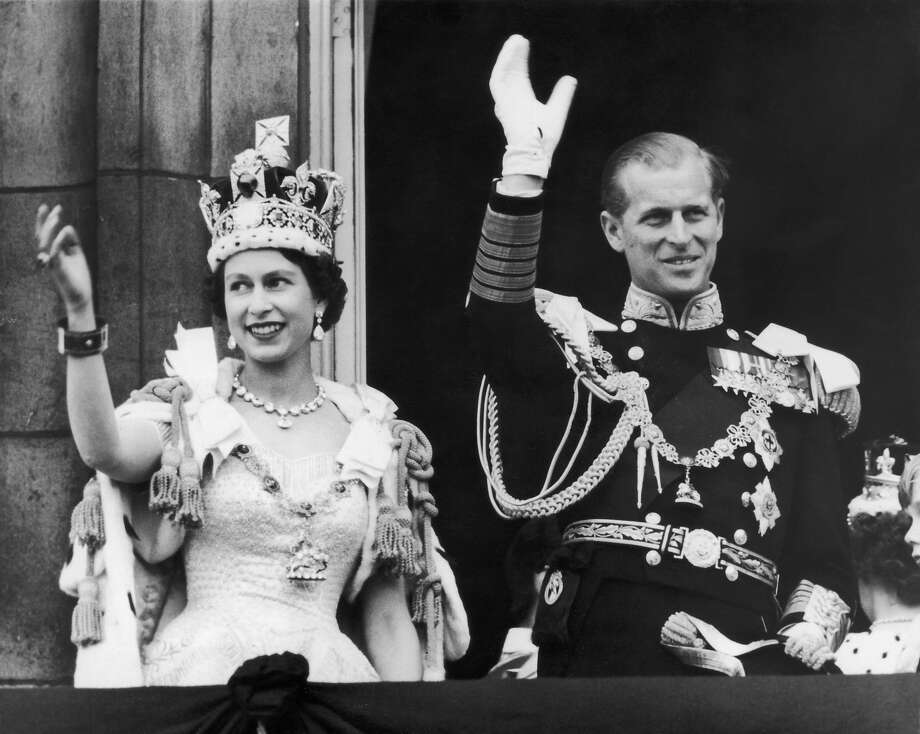 Queen Elizabeth II and the Duke of Edinburgh wave at the crowds from the balcony at Buckingham Palace after the coronation ceremony on June 2, 1953. Photo: Keystone, Getty Images / Hulton Royals Collection