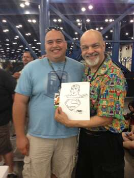 Chronicle reader Chris Kleinz with George Perez