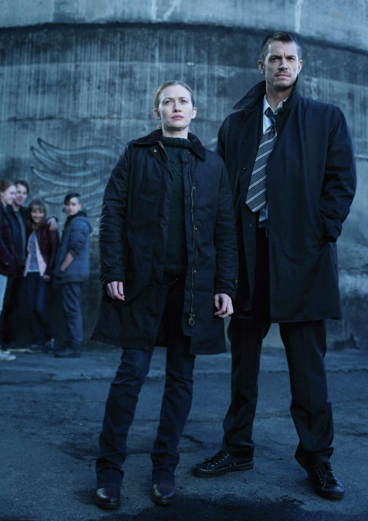 """Kallie Leeds (Cate Sproule) Twitch (Max Fowler), Lyric (Julia Sarah Stone) and Bullet (Bex Taylor-Klaus), in background, and Sarah Linden (Mireille Enos), foreground left, and Stephen Holder (Joel Kinnaman) star in AMC's, """"The Killing,"""" Season 3. (Frank Ockenfels/Courtesy AMC/MCT)"""