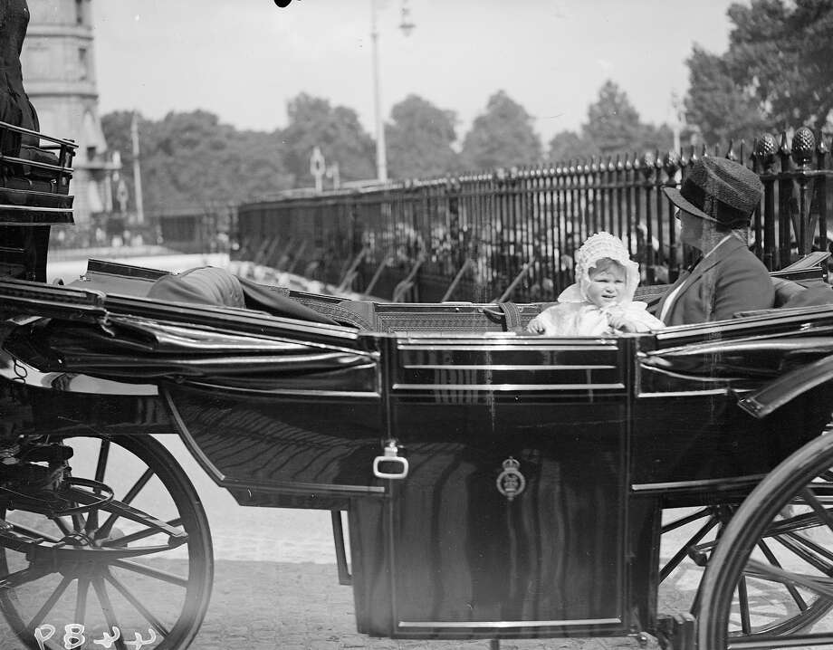 Baby Princess Elizabeth setting off for a coach ride with her nanny in 1927. Photo: Fox Photos, Getty Images / Hulton Royals Collection