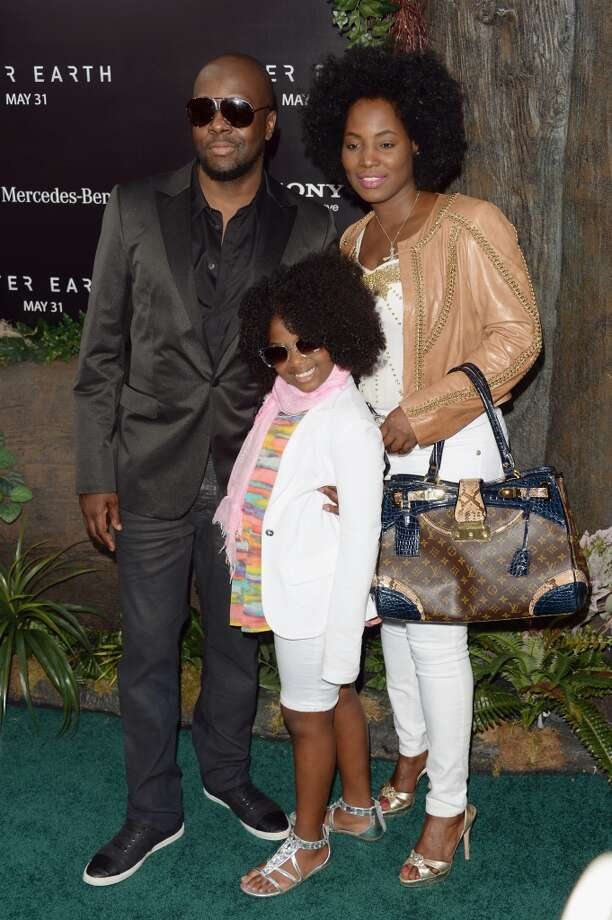 "NEW YORK, NY - MAY 29:  Wyclef Jean, wife Claudenette Jean and daughter Angelina Claudinelle Jean attend the ""After Earth"" premiere at the Ziegfeld Theater on May 29, 2013 in New York City.  (Photo by Andrew H. Walker/Getty Images)"